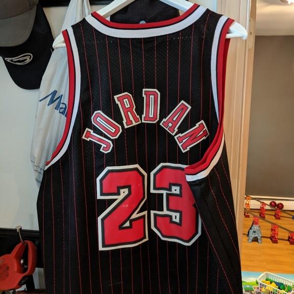 detailed look 1c43f dc2ba Nike Michael Jordan Bulls Jersey Black and Red
